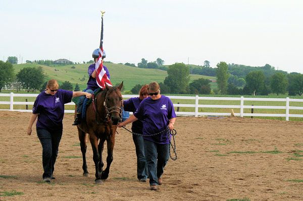 Presentation of the United States flag, presented by a STARS rider.